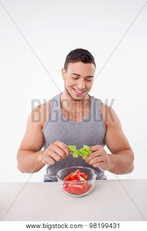 Attractive young man is preparing healthy food