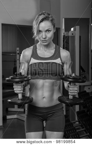 Strong sexy woman with dumbells.