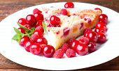 Постер, плакат: Detail Of Single Portion Of Fruit Pie With Berries Around