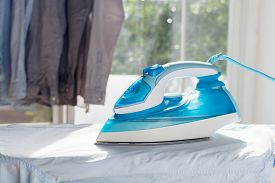 foto of apparel  - ironing housework ironed folded shirts clean concept still life garment apparel cloth indoors - JPG