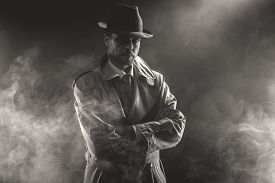 picture of 1950s style  - Mysterious man waiting with arms crossed in the fog 1950s style film noir - JPG
