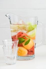 foto of honeydew melon  - Infused water with watermelon Galia melon honeydew and mint in a pitcher - JPG