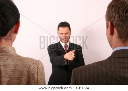 Handsome Business Man Pointing At Man  1