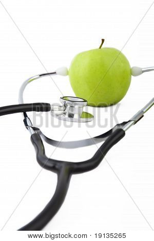 Stethoscope and green apple.