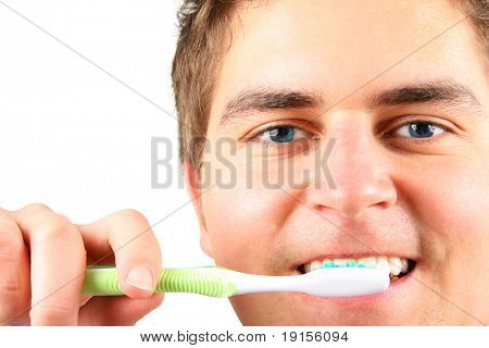 young man is washing teeth over white background