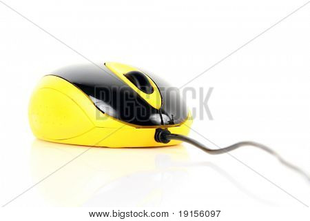 black and yellow computer mouse over white background
