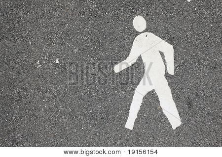 white painted man over black asphalt surface