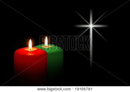 Christmas candles with star light and black background