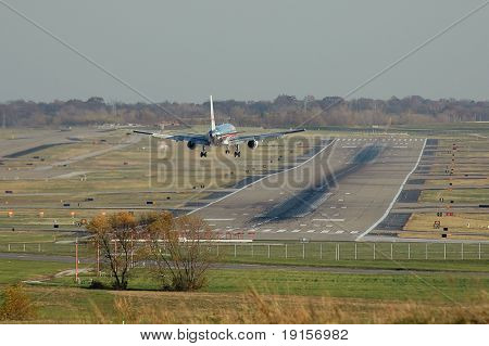 American Airlines plane before landing with airport view