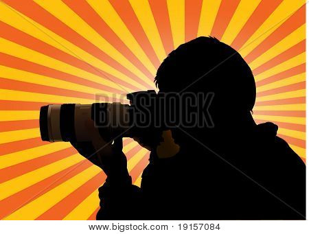 Photographer silhouette with sunburst as background