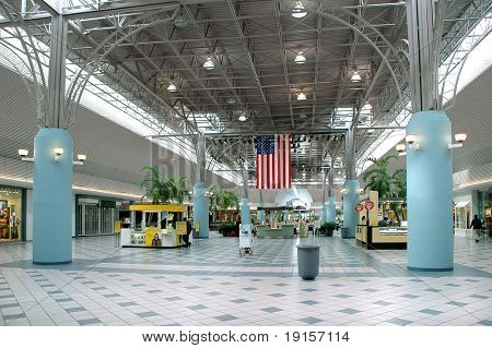 Inside a mall with american flag