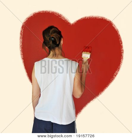 Young woman looking at hart painted on the wall