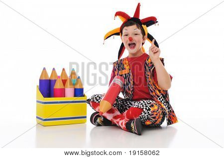 Clown boy holding color pencils isolated on a white background