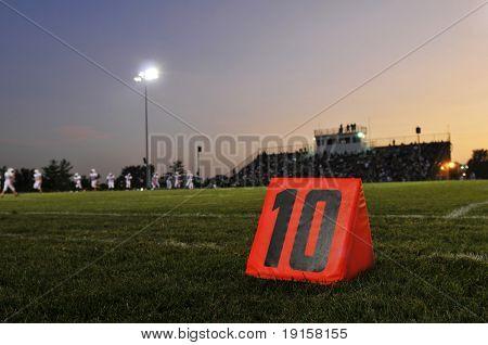 Football field at the 10th yard at night