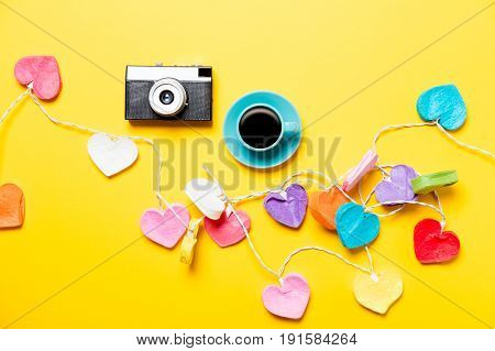 Colored Heart Shape Lights And Cup Of Coffee With Camera