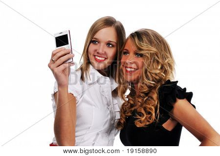 Young girls with cell phone taking a photo isolated on white