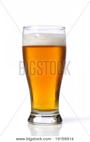 Beer on a glass isolated against a white background