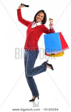 Woman with credit card and shopping bags and holding a cell phone