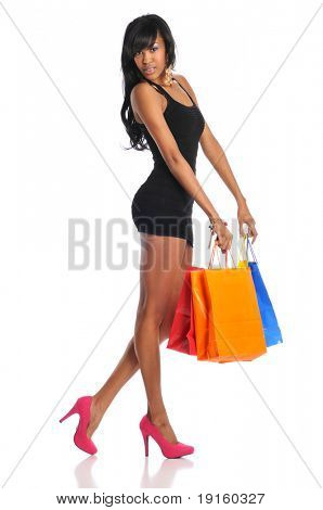 Young African American woman shopping bags isolated on a white background
