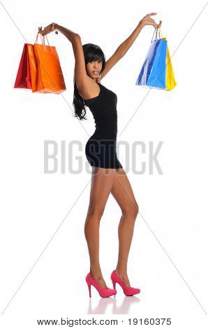 Young African American woman with shopping bags isolated on a white background