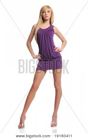 Young teen woman wearing a purple dress posing isolated on a white background