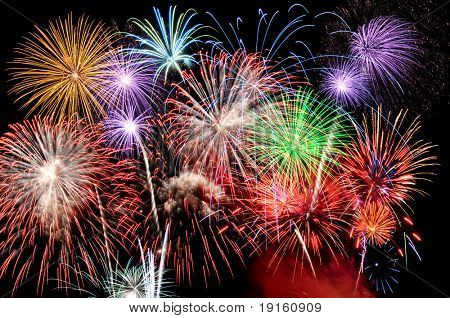 Fireworks of various colors busting against a black sky