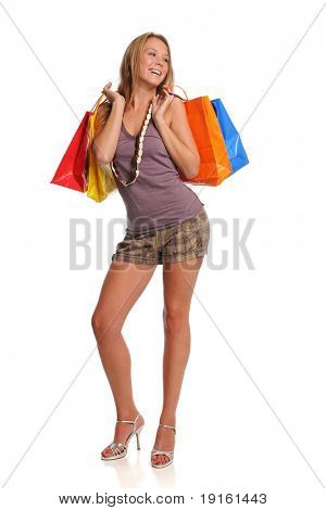 Young Blond woman holding shopping bags isolated on a white background