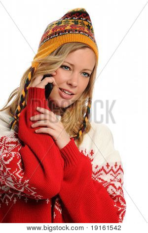 Young Woman wearing winter attire on the cell phone isolated on a white background