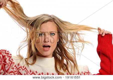 Young Blond Woman pulling her hair isolated on a white background