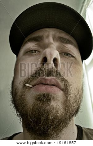 Close-up portrait of an arrogant man - shallow DOF – focus on mouth and nose