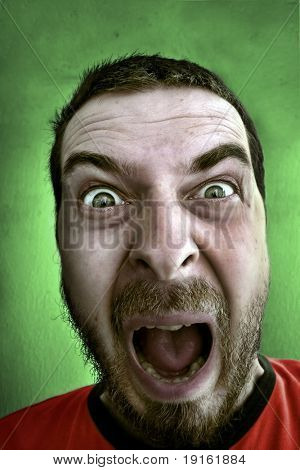 Portrait of shouting shocked man
