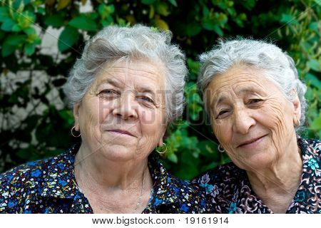 Portrait of two smiling and happy old ladies