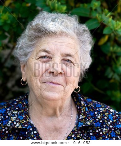 Portrait of happy and smiling senior lady