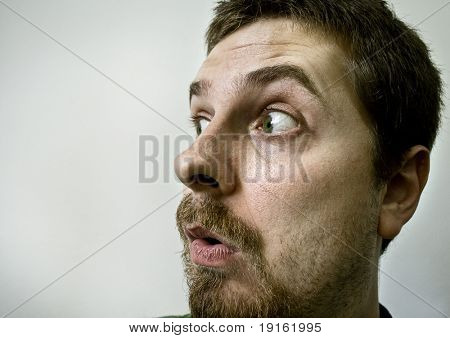 Funny guy with a surprised expression on his face