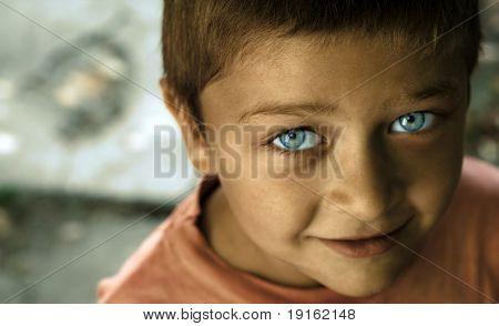 Fine art portrait of cute kid with blue eyes
