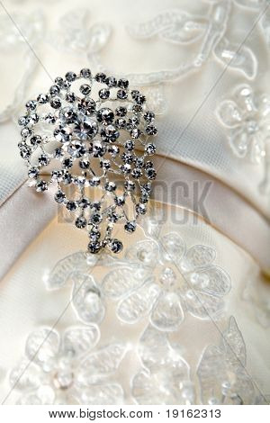 Silver brooch on luxury vintage wedding dress