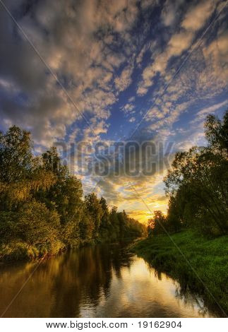 Sunset. Summer river. It is photographed in Russia. 60 kilometers on East from Moscow.