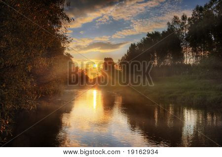 Sunset around lake. It is photographed in Russia. 60 kilometers from Moscow. The end of summer.