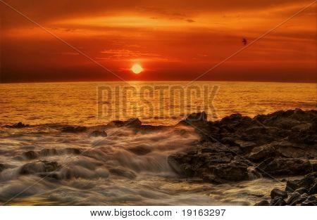 Red sunset of Hawaii. Photographed in Kona on Big Island. Hawaii. USA