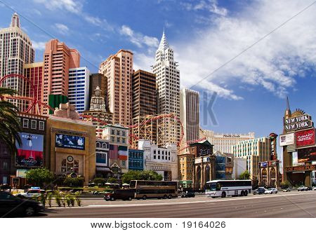 LAS VEGAS â?? MAY 2: Automobiles and tourist buses travel past the New York, New York Hotel & Casino on May 2, 2007 in Las Vegas. The hotel skyline architecture simulates the real New York City skyline.