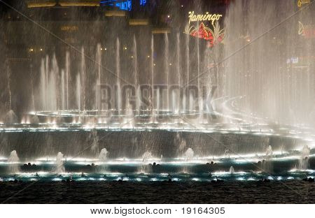 LAS VEGAS, MAY 2, 2007: Dancing musical fountains of the Bellagio Hotel on Flamingo Casino background, May 2, 2007. The fountain has 1175 jets of water 80 meters high, 4500 lamps of light at a cost of $40 million to build.