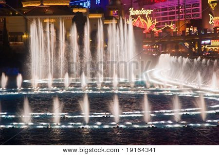LAS VEGAS, MAY 2, 2007: Musical fountains of Bellagio Hotel on Flamingo Casino background, May 2, 2007. The fountain has 1175 jets of water 80 meters high, 4500 lamps of light at a cost of $40 million to build.