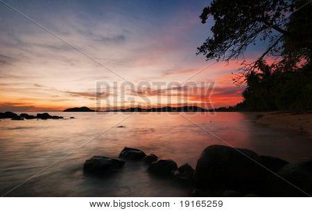 Sunset on tropical beach. Siam bay. Province Trat. Koh Mak island. Kingdom Thailand