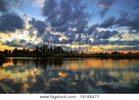 Pink sunset around the lake. It is photographed in Russia. 60 kilometers from Moscow.