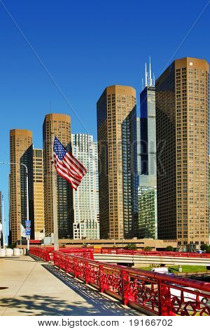 American flag on Chicago downtown background