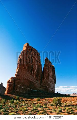 Lonely rock under blue sky. Arches Canyon. Utah. USA