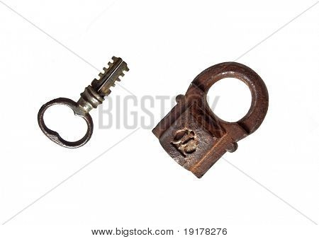 Antic open lock and key on white background. 1866 Year produced
