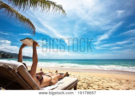 Relaxing and reading on the beach