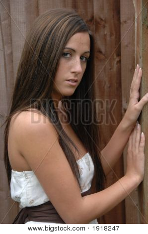 Attractive Female By Fence