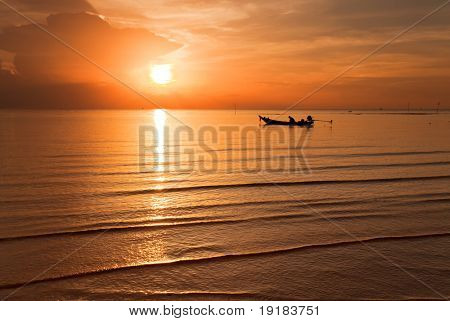A beautiful Sunset seen the fishing boat.